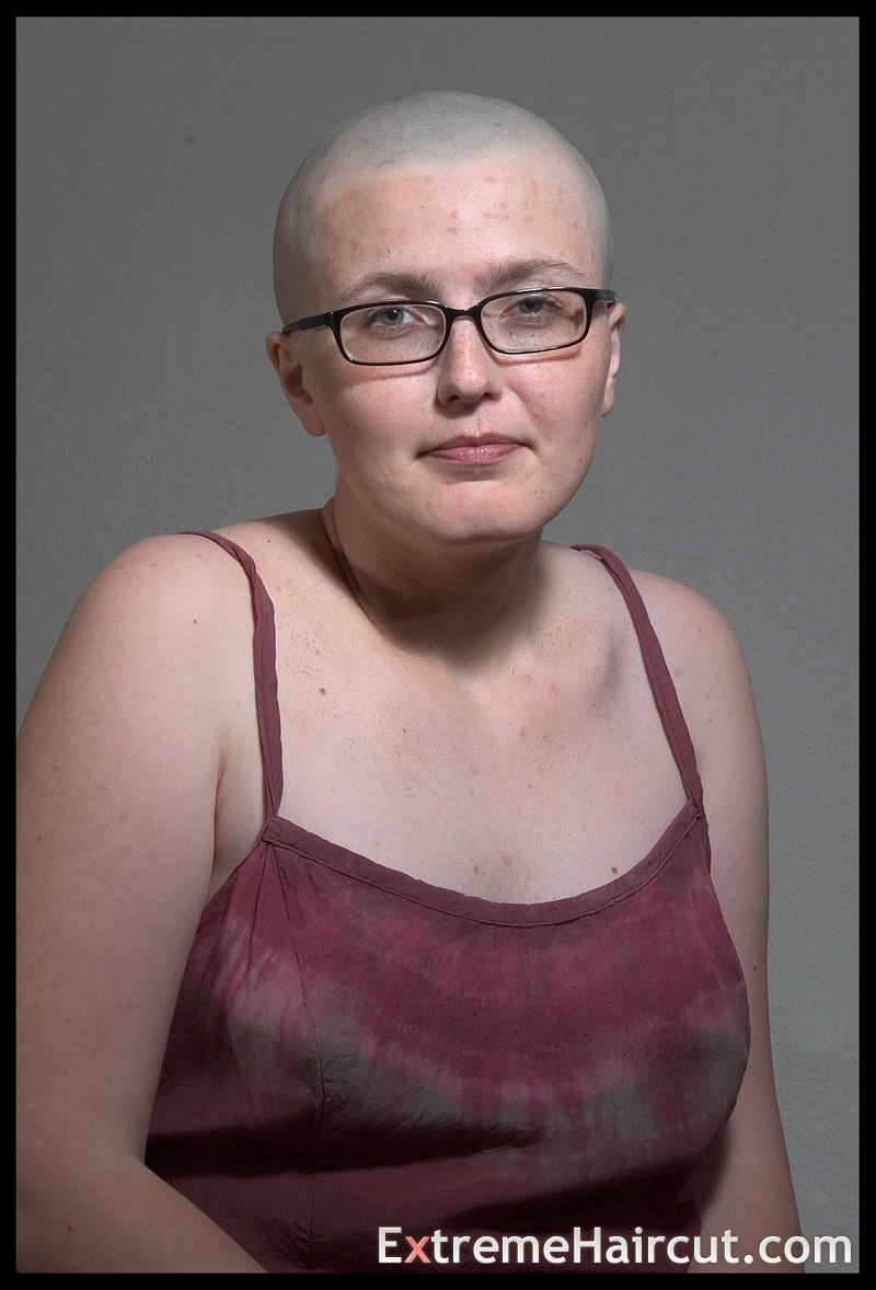 bald girl with glasses